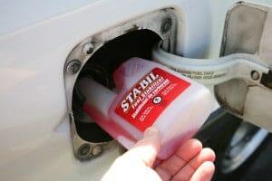putting diesel fuel additive in a car