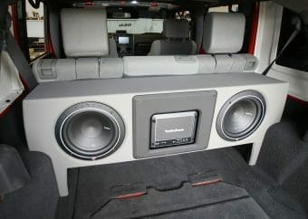 A 10 inch subwoofer installed in a car